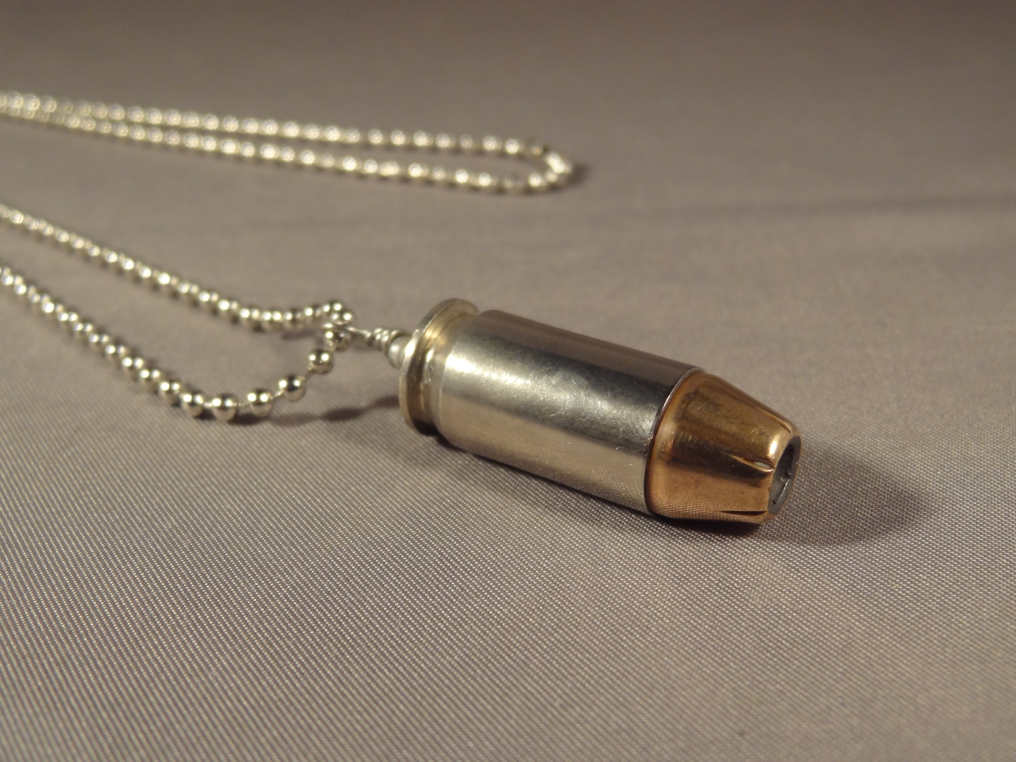 20 ACP Cartridge  Nickel Plated Case and Hollow Point Bullet ...