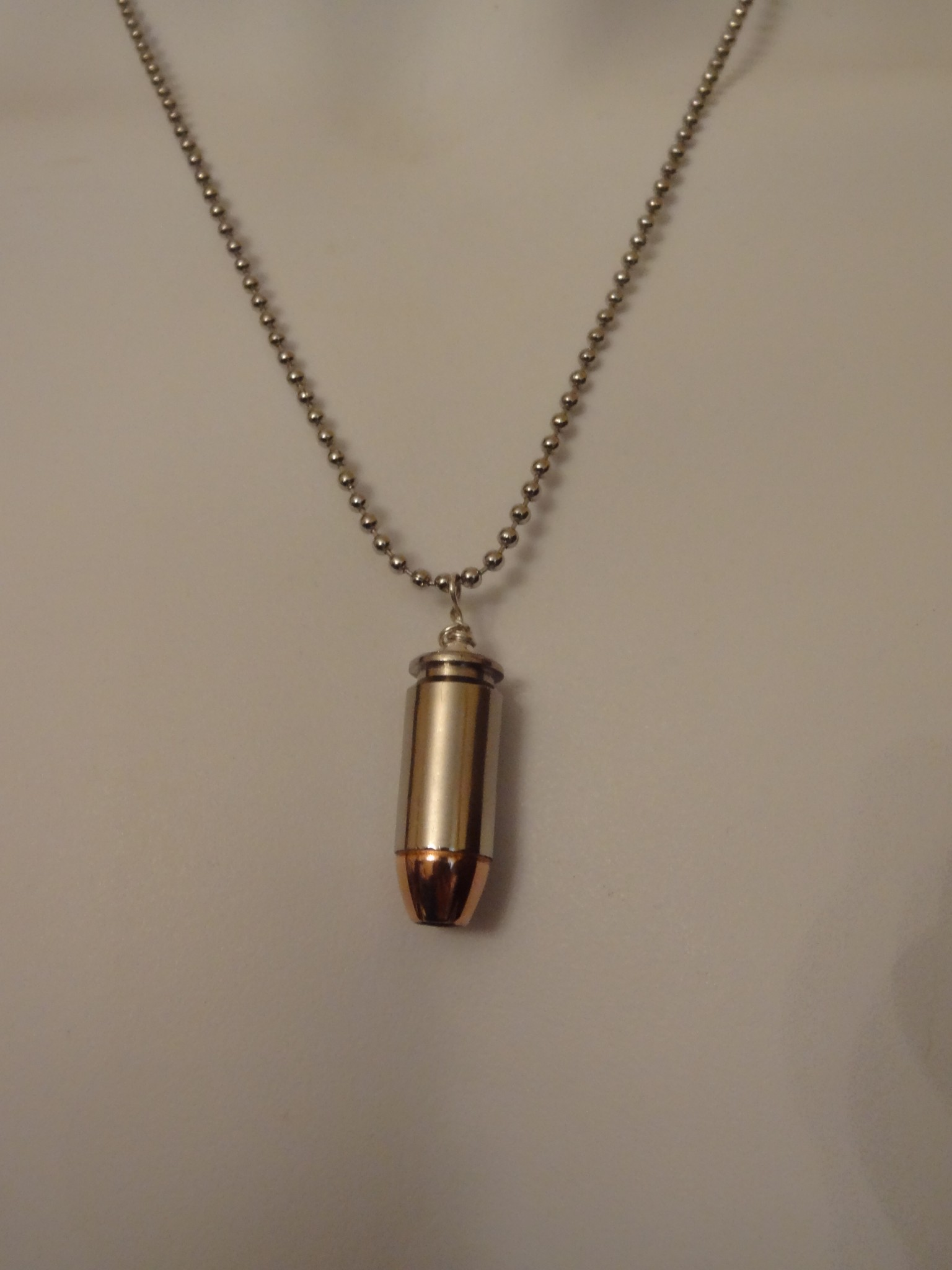 .40 Caliber Cartridge-Nickel Plated Case & Hollow Point Bullet