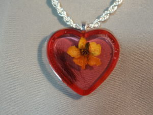 Resin heart necklace with loved one's hair